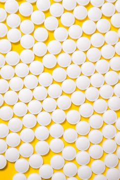 Canva - White Medication Pills Isolated on Yellow background